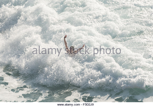 Treen, Cornwall, UK. 2nd November 2015. UK Weather.  Hot sunshine brings nudists to the beach and sea in SW Cornwall. - Stock Image