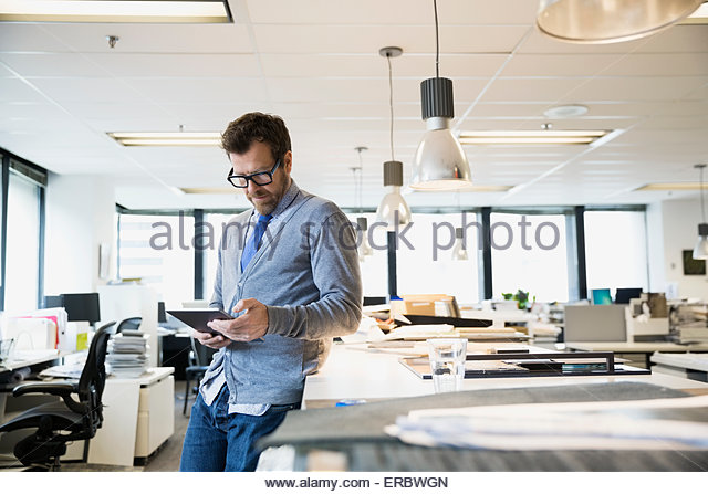 Designer using digital tablet in office - Stock-Bilder