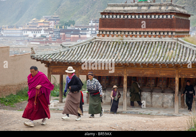 Early morning prayer walk around the twon of Xiahe Gansu China. - Stock Image