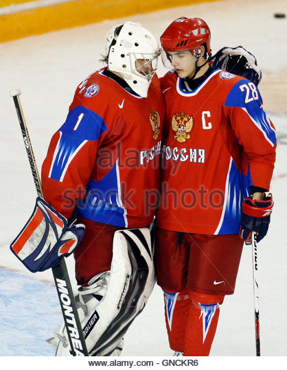 Team Russia goalie Vadim Zhelobnyuk (L) and captain Nikita Filatov embrace after their team defeated Team Slovakia - Stock Image
