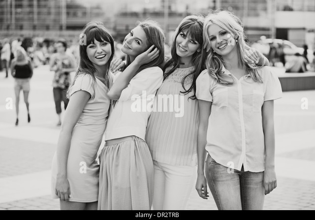 Black&white photo of the cheerful ladies - Stock Image