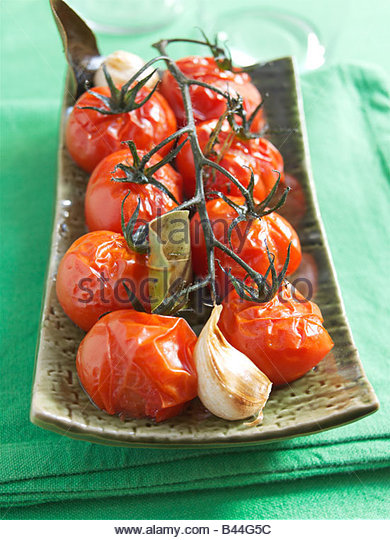 Cooked bunch of tomatoes - Stock Image