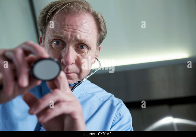 Doctor using stethoscope, personal perspective - Stock Image