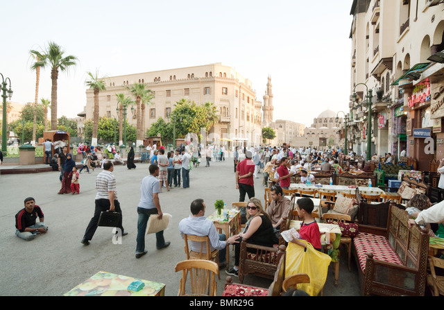 People congregating in the restaurants and cafes of the Islamic quarter, Cairo, Egypt - Stock Image