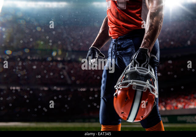 American football sportsman player in olympic stadium - Stock Image
