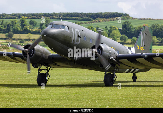Douglas C-47 Skytrain taxiing to its parking position at Duxford. - Stock Image