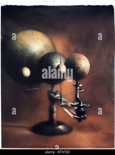 Polaroid transfer of old Orrery on modeled background. - Stock Image