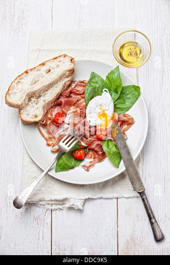 Ham salad with poached egg - Stock Image