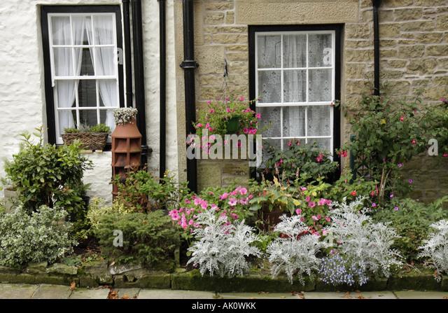 UK, England, Alston, Butt Mews, garden, window, - Stock Image