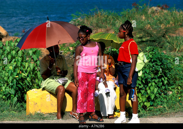 British Virgin Islands Tortola people dressed in bright colorful clothing - Stock Image