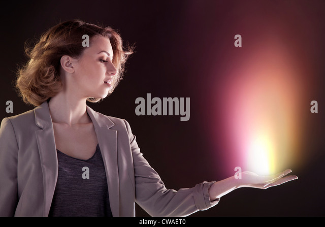 Young woman with light in her hand - Stock Image