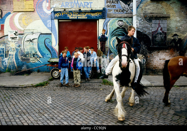 Boys show off their skills with ponies in Dublin's Smithfield Market -Ireland - Stock Image
