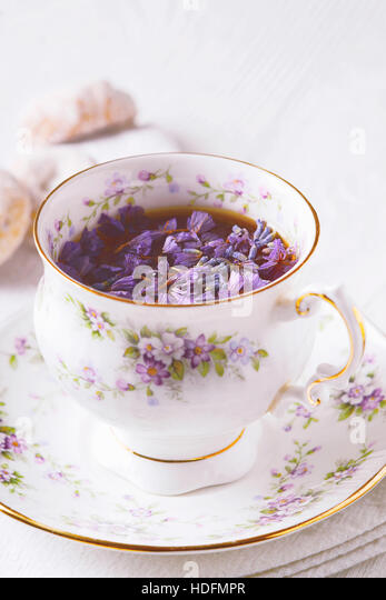 Beautiful cup of tea with flowers vertical - Stock Image