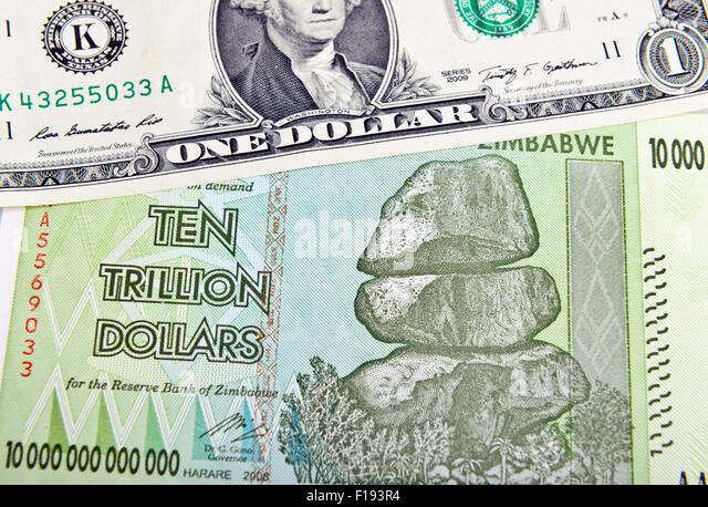 Zimbabwe ten trillion dollars bill and one American dollar. Inflation concept - Stock Image