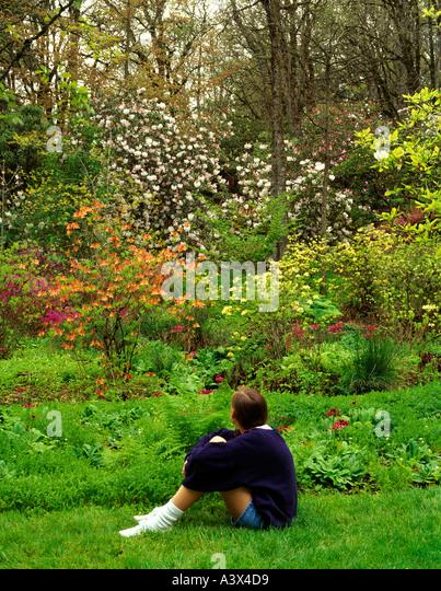 Young girl sitting at Hendricks Park Eugene Oregon - Stock Image