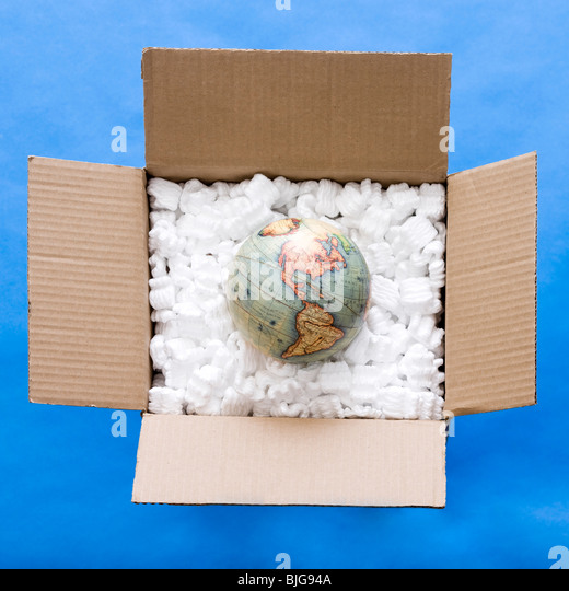 globe in a box full of packing material - Stock Image