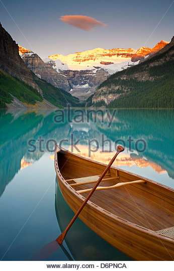 Canoe on Lake Louise at Sunrise, Lake Louise, Banff National Park, Alberta, Canada - Stock Image