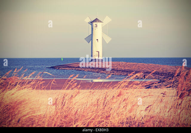 Retro vintage stylized lighthouse, Swinoujscie in Poland. - Stock Image
