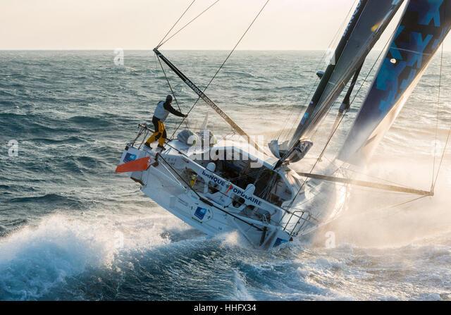 Yacht race Vendée Globe 2017: Armel Le Cléac'h aboard the Banque Populaire VIII monohull sailing (2017/01/19) - Stock Image