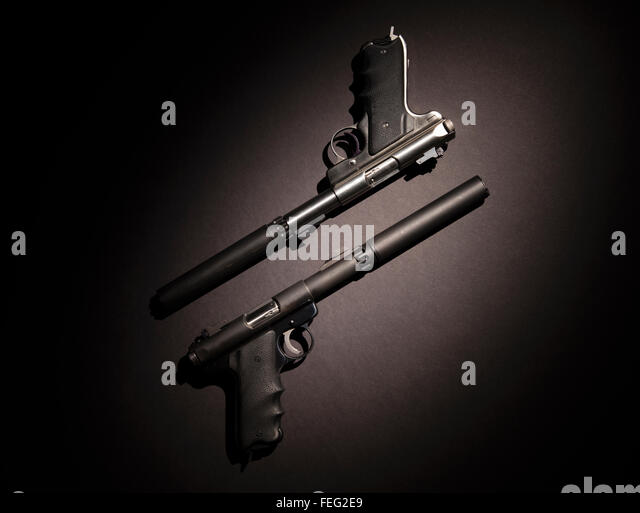 Two semiautomatic handguns with silencers on black background. - Stock-Bilder