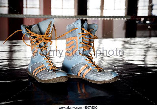 Close up of boxers boots on a training floor - Stock Image
