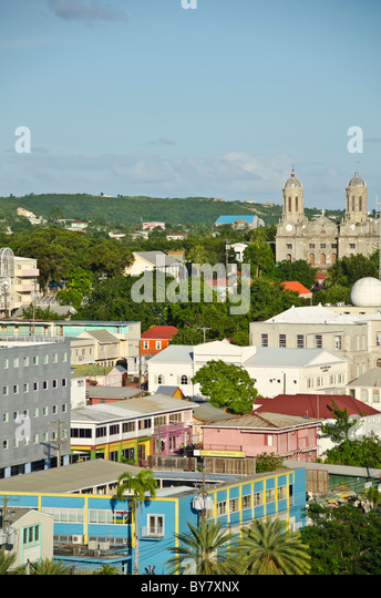 St Johns Antigua cityscape overview houses buildings and churches from Caribbean cruise ship - Stock Image