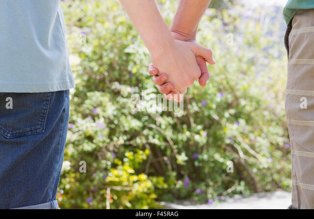 Close up of homosexual couple holding hands - Stock-Bilder