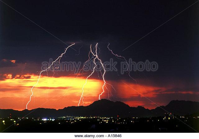 Lightningbolts at sunset over Tucson Mountains Arizona - Stock Image