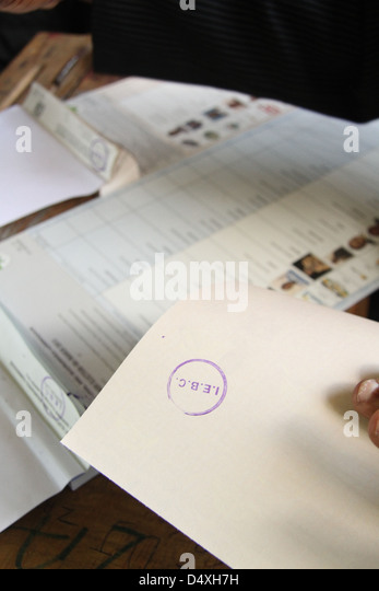 IEBC Official prepares ballot papers for voters - Stock Image
