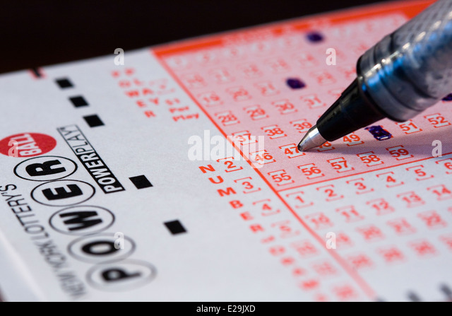 Close up of a ball point pen choosing numbers for the New York Lottery's Powerball Game - Stock Image