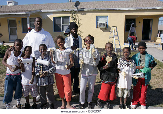 Miami Florida Liberty City Liberty Square public housing Hands On Miami volunteer Martin Luther King Jr. Day of - Stock Image