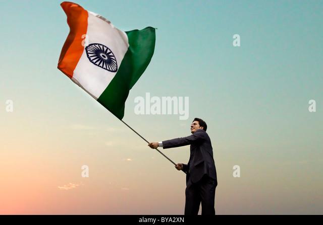 Businessman holding the Indian flag - Stock-Bilder
