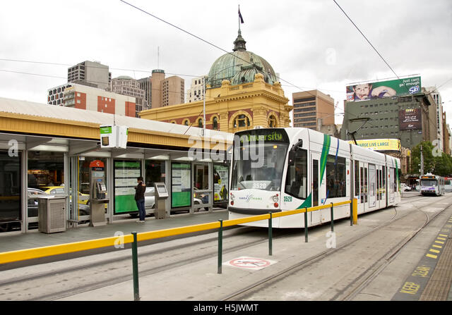 Trams at Flinders Street Station in Melbourne, Australia - November 04 2009: trams and train station - Stock Image