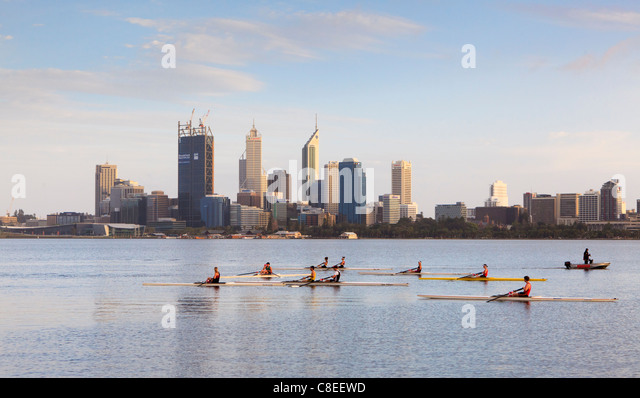 Rowing boats and rowers on the Swan River. - Stock Image