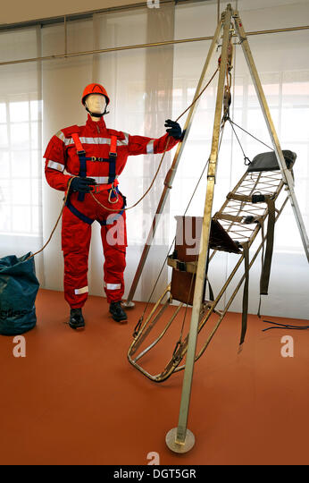 High-angle rescue suit with equipment from the fire department, 'Feuer und Flamme – Die Feuerwehr von 1850 bis - Stock Image