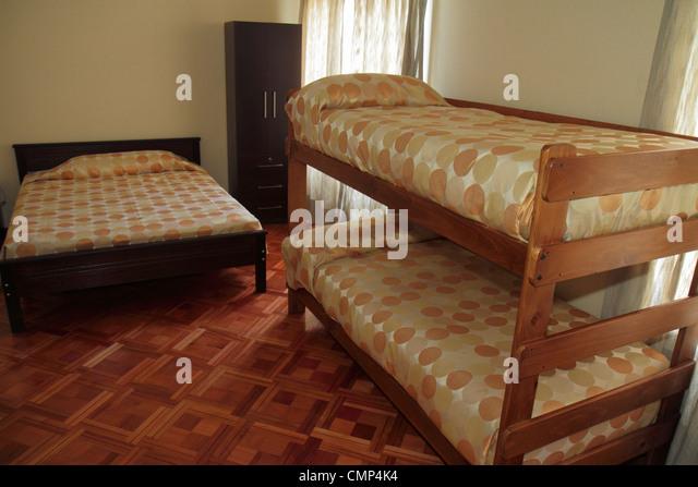 Chile Santiago Providencia Avenida Vicuna Mackenna Hostal Providencia hostel lodging budget backpackers bunk beds - Stock Image