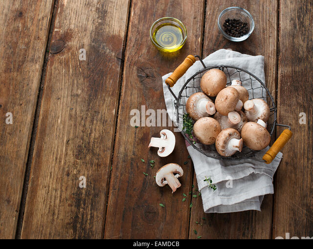 Fresh champignon mushrooms - Stock Image