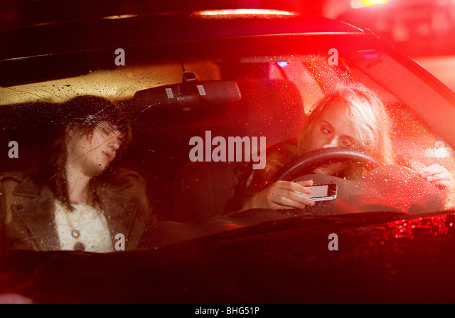 Two young women in a car accident - Stock Image