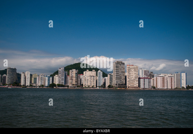 Shore line view of buildings of São Vicente, city in coast of São Paulo state, Brazil - Stock Image