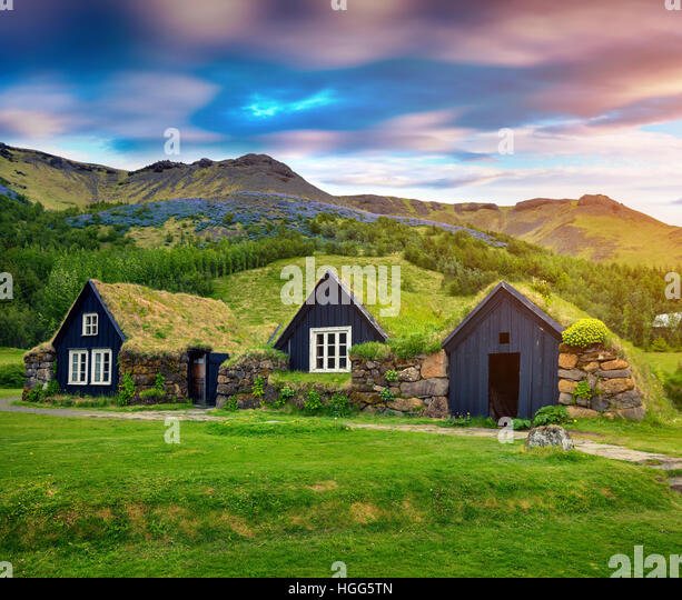 Tipical view of Icelandic turf-top  houses. Colorful summer morning in the Skogar village, south Iceland, Europe. - Stock Image