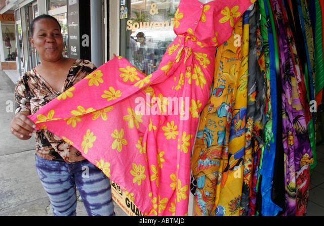 Saint Martin Marigot French Rue Charles De Gaulle Black female tropical dresses - Stock Image