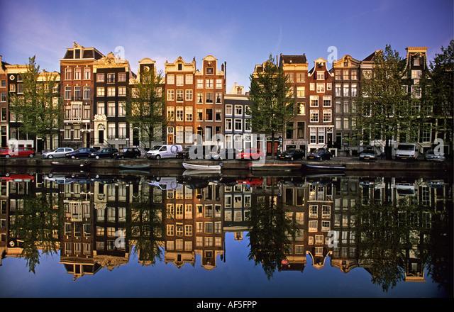 Netherlands Amsterdam Reflection of building in canal called Singel - Stock-Bilder