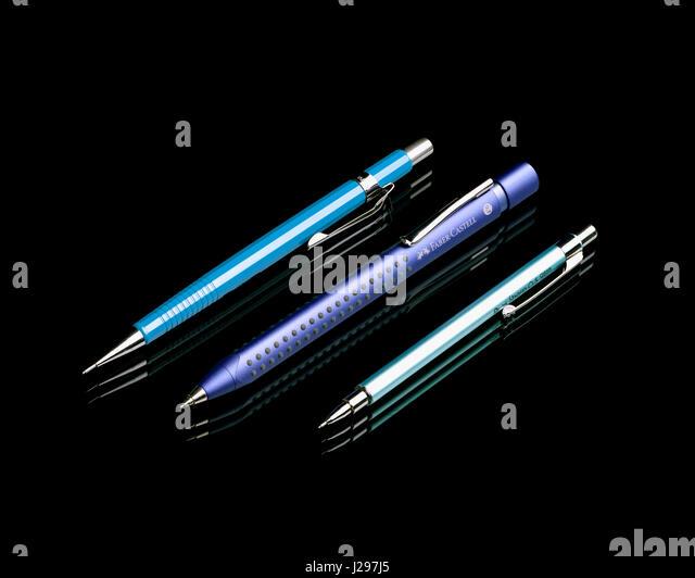 Three mechanical pencils on black background - Stock Image
