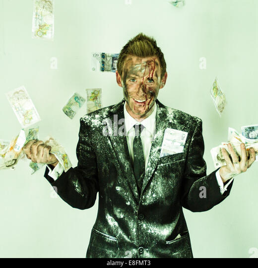 Man in suit laughing and money - Stock Image
