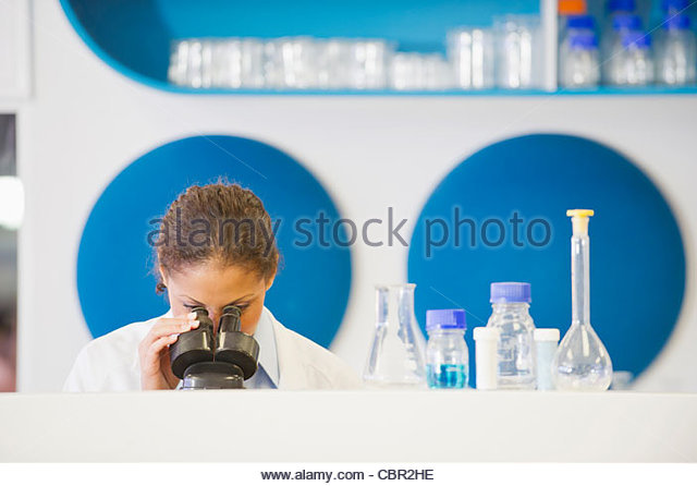 Mixed race scientist working in laboratory - Stock Image