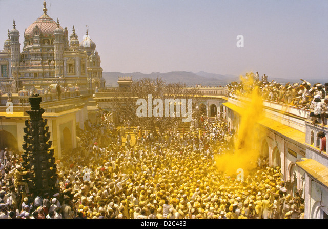 As Palanquin Carrying Images Khandoba Malshabai Circumvent Temple Exuberant Crowd Showers Tumeric Powder Coloring - Stock Image