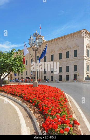 Auberge de Castile building in Valletta which is the office of the Prime Minister of Malta seen with Geraniums in - Stock Image