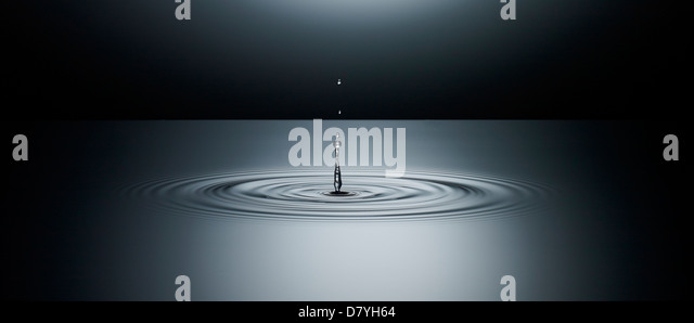 Water splashing in puddle - Stock Image