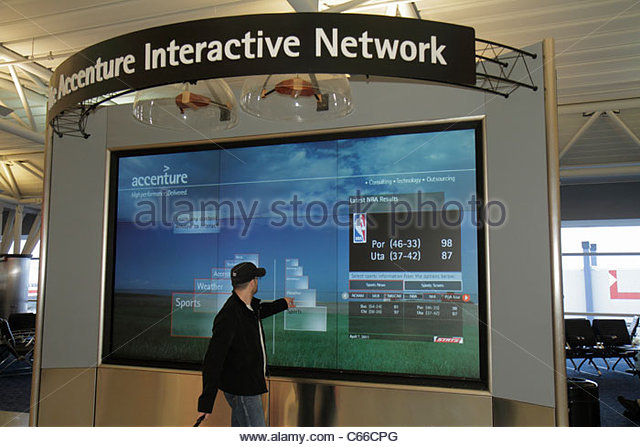Brooklyn New York City NYC NY John F. Kennedy International Airport JFK Accenture Interactive Network touch screen - Stock Image