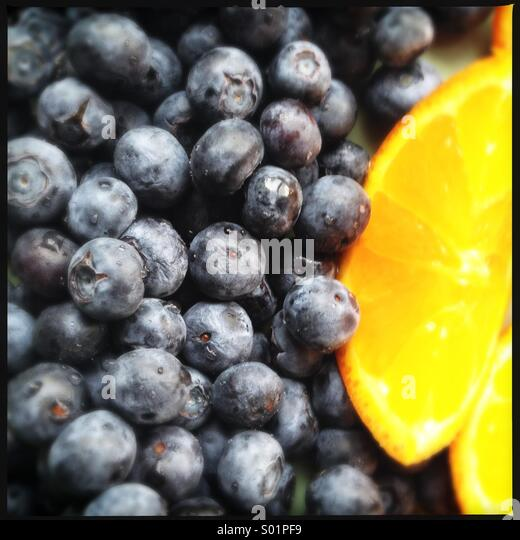 Blueberries and Orange Slice - Stock Image